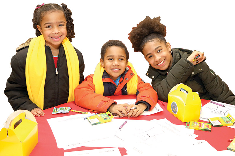 students smiling at table